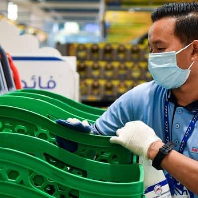 In Dubai an employee sterilises shopping Carts at The Hypermarket Prevent Coronavirus Disease